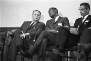 Congressman Carl Elliott seated with two other men during a meeting of educators at Alabama State...