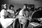 Group of young men and women seated in a class in Crenshaw County, Alabama, sponsored by the...