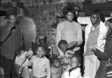 Mrs. Mary Thomas Derico with her five children, being interviewed by staff members of The Southern...
