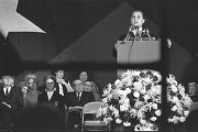 George Wallace speaking on stage at a rally in the Municipal Auditorium in Birmingham, Alabama,...