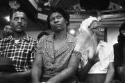 Audience members listening to Martin Luther King, Jr., speak during a meeting at Brown Chapel in...