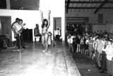 Dancer performing on stage during a performance of Bobby Moore and the Rhythm Aces at a dance at...