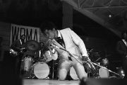James Brown performing on stage at the Alabama State College Arena in Montgomery, Alabama.