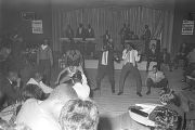 Sugar Pie DeSanto dancing with several men in front of the stage during a performance at the...