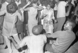People dancing on the floor during a performance by Dyke and the Blazers at the Laicos Club in...