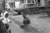 Children playing in the street in front of a house in a neighborhood in Montgomery, Alabama.