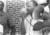 Martin Luther King, Jr., addressing a crowd in front of the Neshoba County Library in...