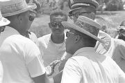 Robert L. Green and Martin Luther King, Jr., speaking to Mississippi Highway Patrol officers...