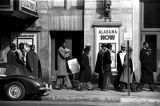 Group marching past the Alabama Theatre on Third Avenue North in Birmingham, Alabama, during a...
