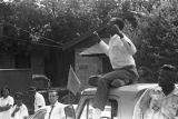 "Man sitting on the roof of a truck during the ""March Against Fear"" through Mississippi,..."