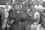 "Fannie Lou Hamer singing to a group of people during the ""March Against Fear"" through..."