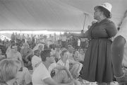 "Fannie Lou Hamer speaking to an audience under a tent during the ""March Against Fear""..."