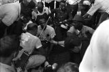 Doctor examining the leg of James Meredith on the campus of Tougaloo College in Mississippi,...