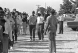 "Participants in the ""March Against Fear"" through Mississippi, walking down a dirt road."