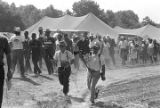 "Participants in the ""March Against Fear"" through Mississippi, walking past tents at a..."