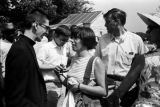 Young woman from the Medical Committee for Human Rights, talking with a clergyman during the...