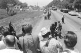 "Participants in the ""March Against Fear"" through Mississippi, walking down a paved road."