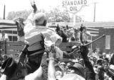 "Ed Fondren being lifted above a crowd during the ""March Against Fear"" through..."