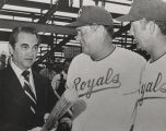 George Wallace with Bob Lemon and George Strickland, manager and coach of the Kansas City Royals,...