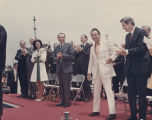 Governor George Wallace on a platform with President Richard Nixon and several Alabama politicians.
