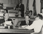 Governor George Wallace speaking to Senators Hubert Humphrey and Jim Allen, who are seated in the...