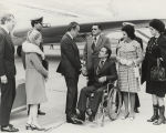 President Richard Nixon shaking hands with George Wallace outside the presidential airplane after...