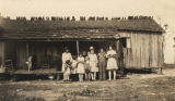 Group of Cajun children standing in front of a home in Mobile County, Alabama.