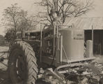 """Colonel Price C. McLemore and his 'Sizz Weeder,' said to be the greatest farm invention..."