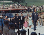 George Wallace and his children walking up the steps of the Capitol at the end of the funeral...