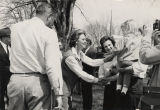 Lurleen Wallace shaking hands with a man and little girl during her gubernatorial campaign.