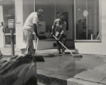 Two men cleaning the blood stain from the sidewalk after Albert Patterson's assassination in...