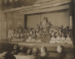 Students on stage during a school performance, probably a patriotic pageant.