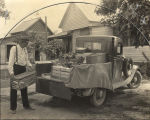 John L. Chambers, a farmer in Boaz, Alabama, loading produce onto his truck to take to market.