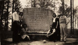Students from Southern Union College in Wadley, Alabama, standing beside a stone marker at the...