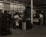 Textile engineering students operating weaving machines at Alabama Polytechnic Institute in...