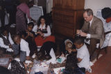 Governor Don Siegelman and his wife, Lori, making Christmas tree ornaments with foster children at...