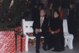 Governor Don Siegelman with his wife, Lori, seated on a bench beside the Christmas tree in front...