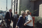 Governor Guy Hunt and his wife, Helen, talking with people outside the office building of The...