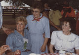 Helen Hunt speaking with two women at a social event during the National Governors Association...