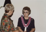 Helen Hunt speaking with a woman at a social event during the National Governors Association...