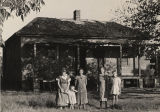 Gillard family standing in front of their home in Barbour County, Alabama.