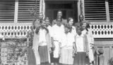 Group of students and teachers at Calhoun Colored School in Lowndes County, Alabama, standing on...