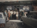 Group of people standing in front of the George Wallace headquarters in La Puente, California,...