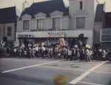 Picketers marching in front of George Wallace headquarters on a downtown street in California,...