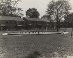 Children in a wading pool in Elyton Village, a federal housing project in Birmingham, Alabama.