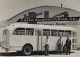 Three men standing in front of a bus built by (and parked at) the Southern Coach Manufacturing...
