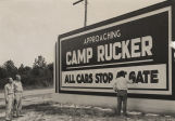 Man painting the sign at the entrance to Camp Rucker in Dale County, Alabama.