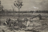 Soldiers in a field during combat training at Camp Rucker in Dale County, Alabama.