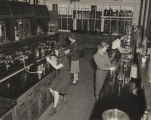 Women working in a chemistry lab at the Goodyear rubber plant in Gadsden, Alabama, during World...