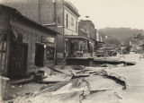 Building and street destroyed by a flood in downtown Prattville, Alabama.